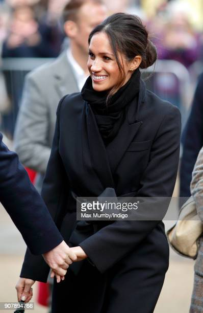 Meghan Markle holds Prince Harry's hand as they visit Cardiff Castle on January 18 2018 in Cardiff Wales