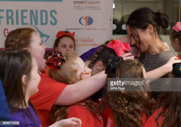 Meghan Markle in a group hug as she attends a street dance class during her visit to Star Hub on January 18 2018 in Cardiff Wales