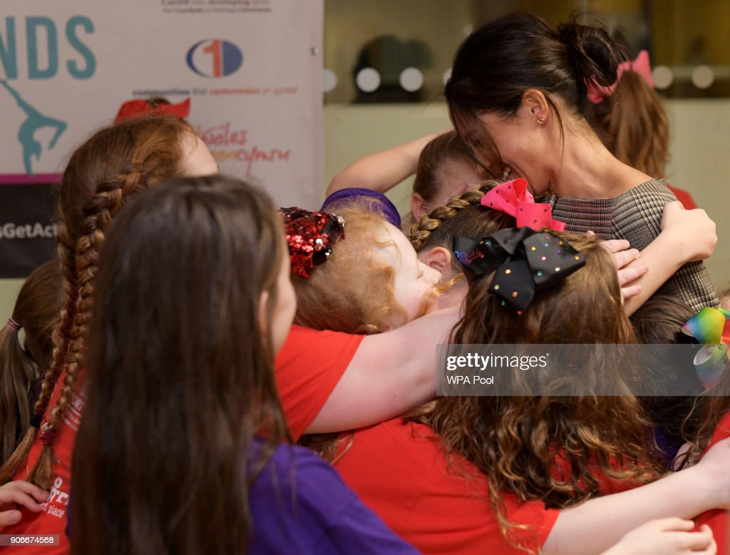 Meghan Markle in a group hug as she attends a street dance class during her visit to Star Hub on January 18, 2018 in Cardiff, Wales.