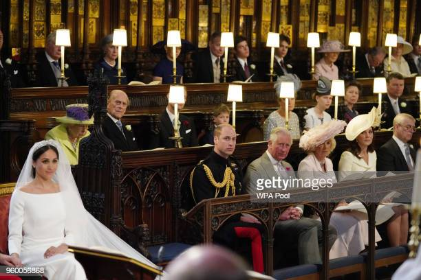 Meghan Markle in St George's Chapel Windsor Castle for her wedding to Prince Harry watched by Queen Elizabeth II Duke of Edinburgh Earl of Wessex...