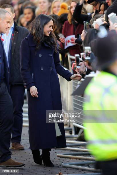 Meghan Markle is greeted by crowd as she arrives to Nottingham Contemporary on December 1 2017 in Nottingham England Prince Harry and Meghan Markle...