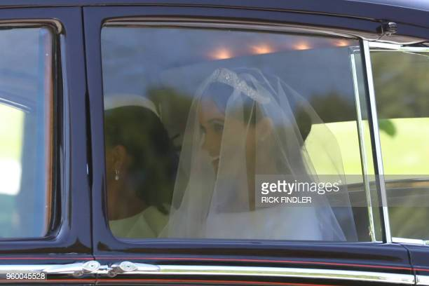 Meghan Markle leaves Cliveden House Hotel accompanied by her mother Doria Ragland for the wedding ceremony to marry Britain's Prince Harry Duke of...