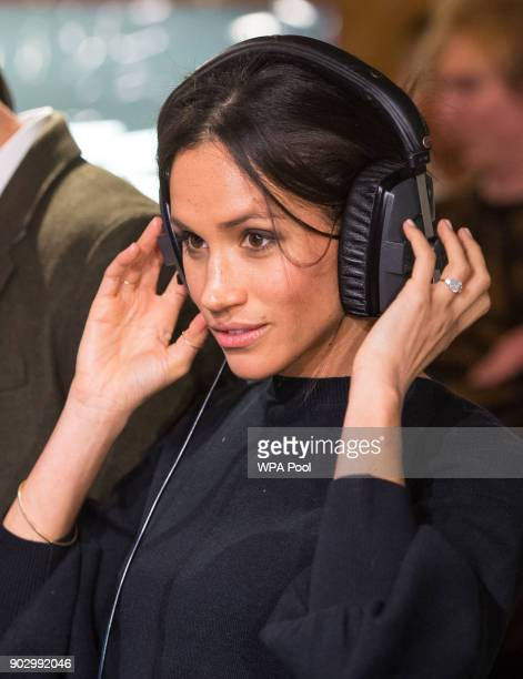 Meghan Markle listens to a broadcast through headphones at Reprezent 1073FM in Pop Brixton on January 9 2018 in London England The Reprezent training...
