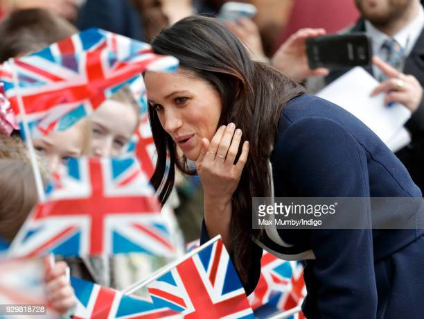 Meghan Markle meets children during a walkabout at Millennium Point before attending an event to celebrate International Women's Day on March 8 2018...