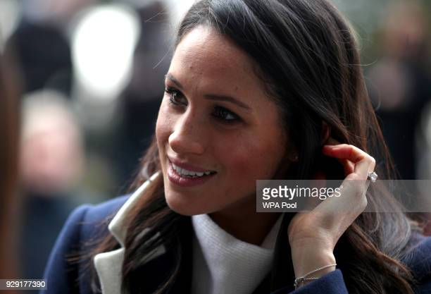 Meghan Markle meets local school children during a walkabout with Britain's Prince Harry on a visit to Birmingham on March 8 2018 in Birmingham...