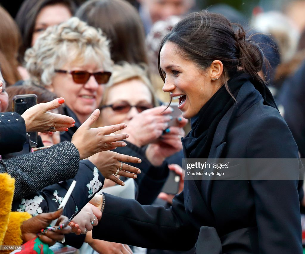 Meghan Markle meets members of the public during a walkabout as she visits Cardiff Castle on January 18, 2018 in Cardiff, Wales.