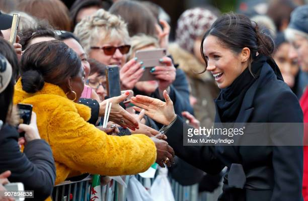 Meghan Markle meets members of the public during a walkabout as she visits Cardiff Castle on January 18 2018 in Cardiff Wales