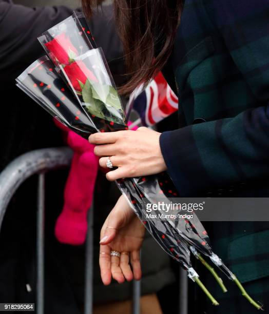 Meghan Markle receives some red roses from a member of the public as she visits Edinburgh Castle on February 13 2018 in Edinburgh Scotland