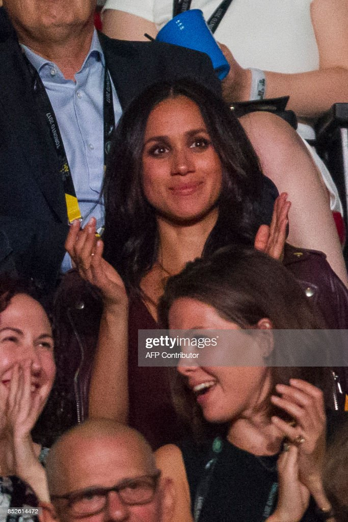 Meghan Markle, said to be Prince Harry's girlfriend, applauds during the opening ceremonies of the Invictus Games in Toronto, Ontario, September 23, 2017. Since the 'Suits' actress, 36, told Vanity Fair the couple are 'in love' in an interview published early this month, fans and the press have been eagerly awaiting an official appearance. According to his schedule, Queen Elizabeth II's grandson plans to stay at Markle's Toronto home for the entire eight days of the Games. PHOTO / Geoff Robins