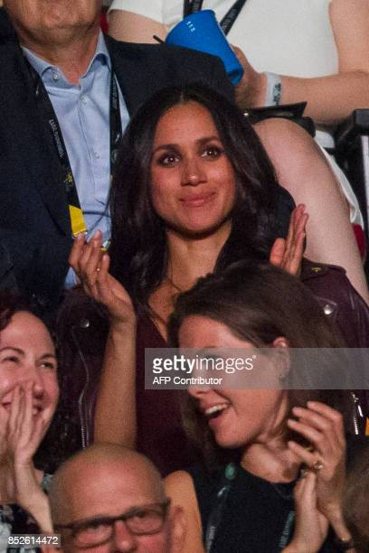 Meghan Markle said to be Prince Harry's girlfriend applauds during the opening ceremonies of the Invictus Games in Toronto Ontario September 23 2017...