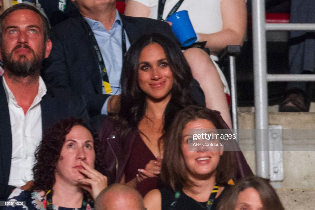 Meghan Markle, said to be Prince Harry's girlfriend, watches the opening ceremonies of the Invictus Games in Toronto, Ontario, September 23, 2017. Since the 'Suits' actress, 36, told Vanity Fair the couple are 'in love' in an interview published early this month, fans and the press have been eagerly awaiting an official appearance. According to his schedule, Queen Elizabeth II's grandson plans to stay at Markle's Toronto home for the entire eight days of the Games. PHOTO / Geoff Robins