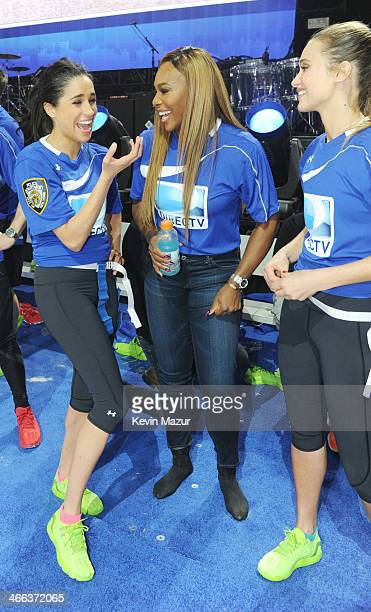 Meghan Markle Serena Williams and Hannah Davis participate in the DirecTV Beach Bowl at Pier 40 on February 1 2014 in New York City
