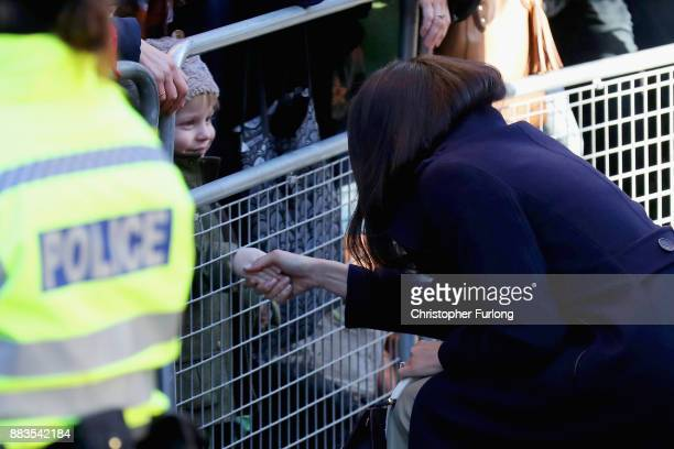 Meghan Markle shakes the hand of a child as she departs Nottingham Contemporary on December 1 2017 in Nottingham England Prince Harry and Meghan...
