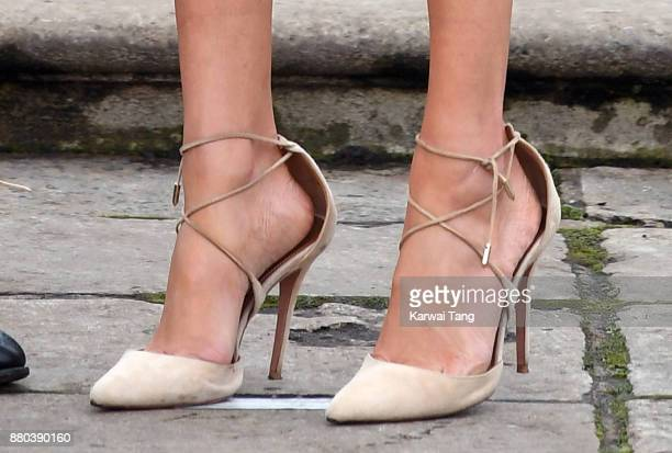 Meghan Markle shoe detail attends an official photocall to announce the engagement of Prince Harry and actress Meghan Markle at The Sunken Gardens at...