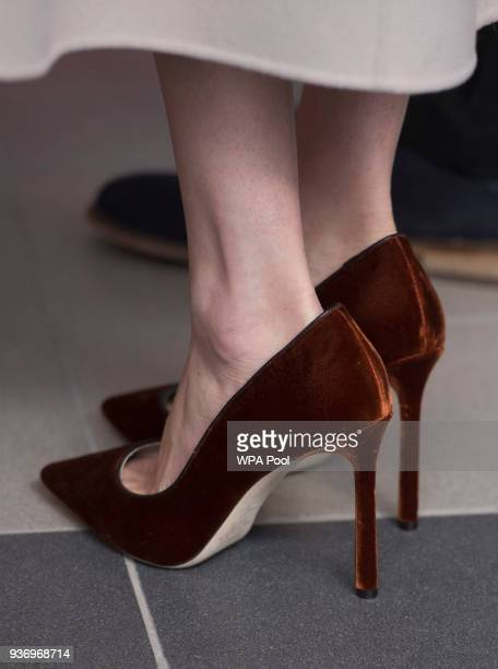 Meghan Markle, shoe detail, smiles during her visit to the Eikon Centre with Prince Harry to attend an event to mark the second year of the youth-led...