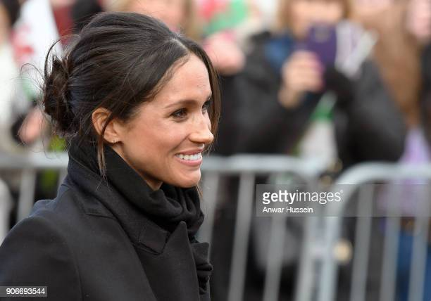 Meghan Markle smiles during a visit Cardiff Castle with Prince Harry on January 18 2018 in Cardiff Wales