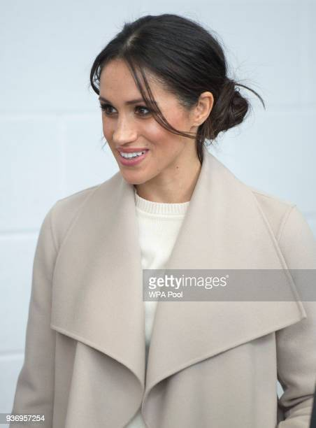 Meghan Markle smiles during her visit to the Eikon Centre with Prince Harry to attend an event to mark the second year of the youthled peacebuilding...