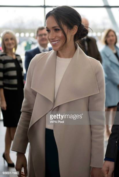 Meghan Markle smiles during her visit to the Eikon Centre wuith Prince Harry to attend an event to mark the second year of the youthled peacebuilding...
