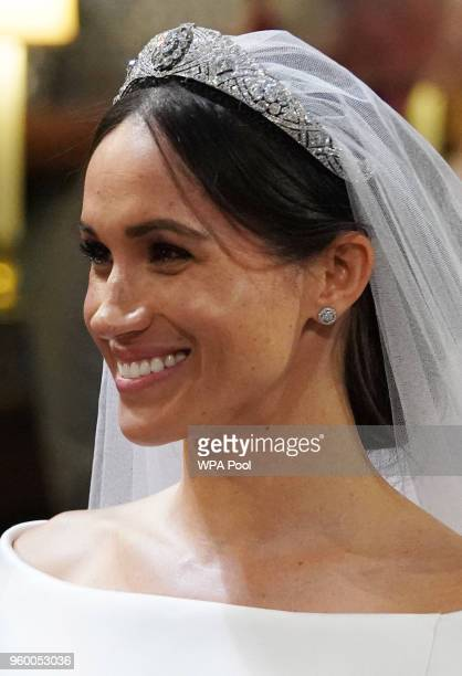 Meghan Markle smiles during her wedding to Prince Harry in St George's Chapel at Windsor Castle on May 19 2018 in Windsor England