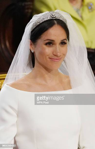 Meghan Markle stands at the altar during her wedding in St George's Chapel at Windsor Castle on May 19 2018 in Windsor England