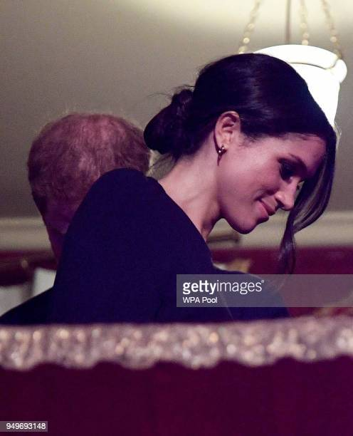 Meghan Markle takes her seat at a starstudded concert to celebrate the Queen's 92nd birthday at the Royal Albert Hall on April 21 2018 in London...