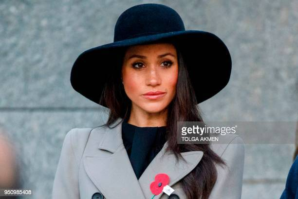 Meghan Markle the US fiancee of Britain's Prince Harry attends an Anzac Day dawn service at Hyde Park Corner in London on April 25 2018 Anzac Day...