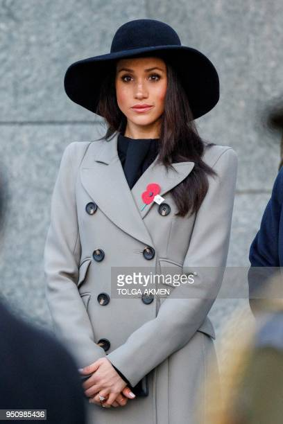 Meghan Markle, the US fiancee of Britain's Prince Harry, attends an Anzac Day dawn service at Hyde Park Corner in London on April 25, 2018. - Anzac...