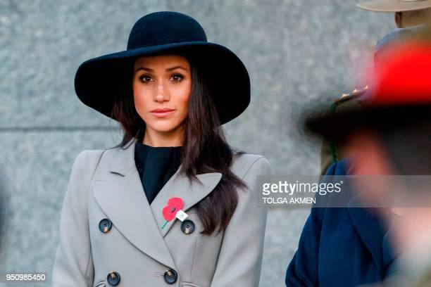 TOPSHOT Meghan Markle the US fiancee of Britain's Prince Harry attends an Anzac Day dawn service at Hyde Park Corner in London on April 25 2018 Anzac...