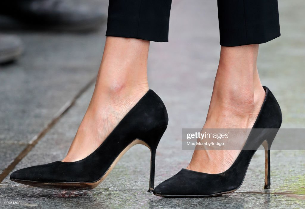 Meghan Markle (shoe detail) visits Millennium Point to attend an event celebrating International Women's Day on March 8, 2018 in Birmingham, England.