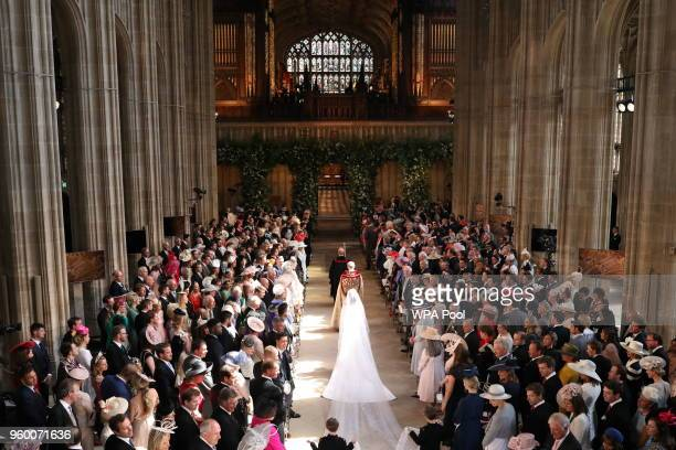 Meghan Markle walks up the aisle in St George's Chapel at Windsor Castle ahead of her wedding to Prince Harry on May 19, 2018 in Windsor, England.