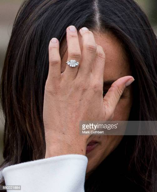 Meghan Markle with her engagemnt ring during an official photocall to announce the engagement of Prince Harry and actress Meghan Markle at The Sunken...