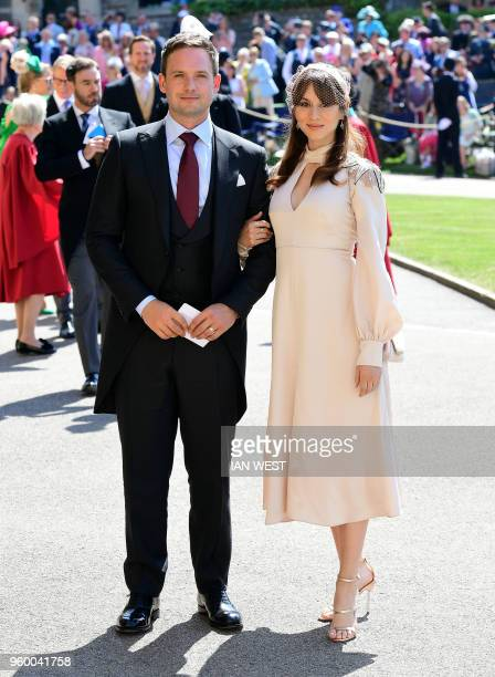 Meghan Markle's friend US actor Patrick J Adams and wife Troian Bellisario arrive for the wedding ceremony of Britain's Prince Harry Duke of Sussex...