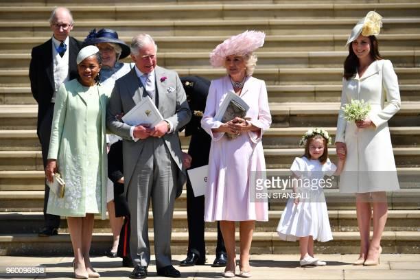 TOPSHOT Meghan Markle's mother Doria Ragland Britain's Prince Charles Prince of Wales Britain's Camilla Duchess of Cornwall Princess Charlotte and...