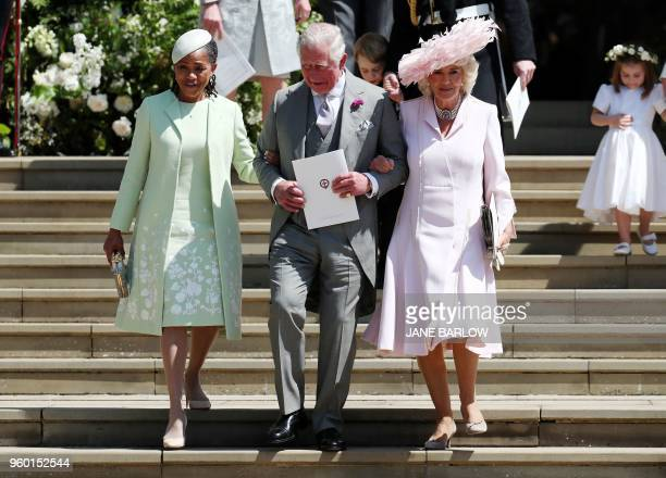 Meghan Markle's mother Doria Ragland Britain's Prince Charles Prince of Wales and Britain's Camilla Duchess of Cornwall leave after the wedding...