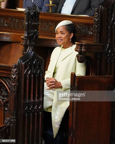 Meghan Markle's mother Doria Ragland takes her seat for the wedding ceremony of Britain's Prince Harry Duke of Sussex and US actress Meghan Markle at...