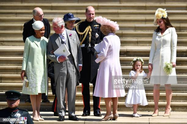 Meghan Markle's mother Doria Ragland talks with Britain's Prince Charles Prince of Wales as Britain's Prince William Duke of Cambridge talks to...