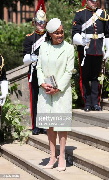 Meghan Markle's mother Doria Ragland walks down the west steps after attending the wedding ceremony of Britain's Prince Harry Duke of Sussex and US...