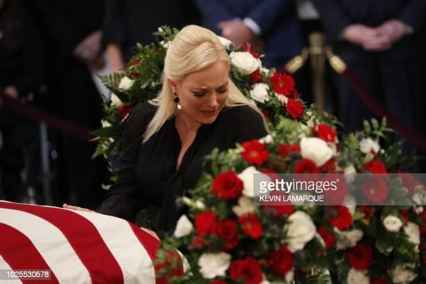 TOPSHOT Meghan McCain daughter of late US Senator John McCain touches her father's casket during ceremonies honoring Senator McCain inside the US...