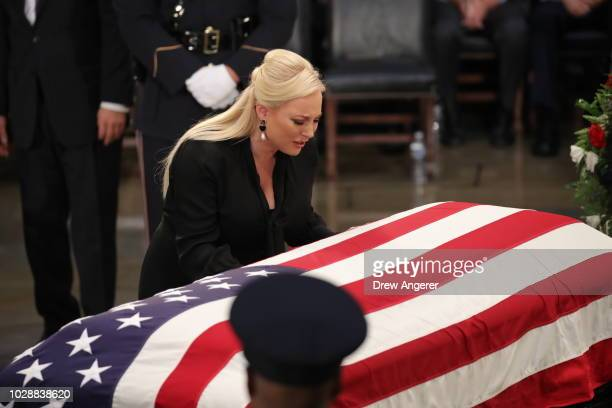 Meghan McCain daughter of Sen John McCain touches the casket during the ceremony honoring the late US Senator inside the Rotunda of the US Capitol...