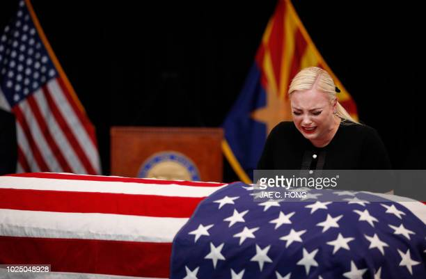 TOPSHOT Meghan McCain daughter of US Senator John McCain grieves over the casket of her father during a memorial service at the Arizona Capitol on...