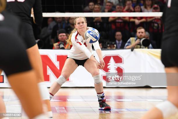 Meghan McClure of the Stanford Cardinal hits a return against the Nebraska Cornhuskers during the Division I Women's Volleyball Championship held at...
