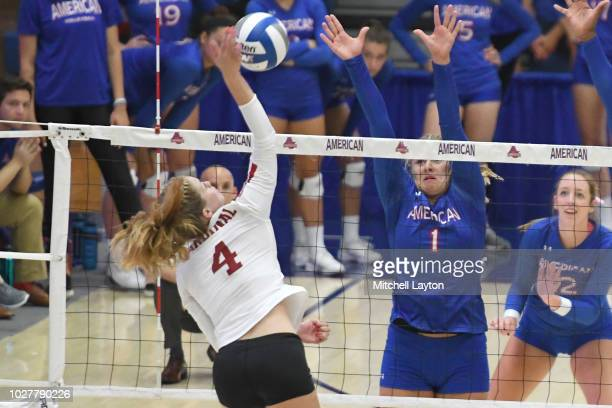 Meghan McClure of the Stanford Cardinals returns a shot during a women's college volleyball match against the American Eagles at Bender Arena on...