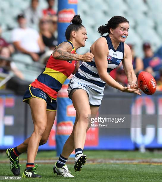 Meghan McDonald of the Cats handballs during the AFLW Preliminary Final match between the Adelaide Crows and thew Geelong Cats at Adelaide Oval on...