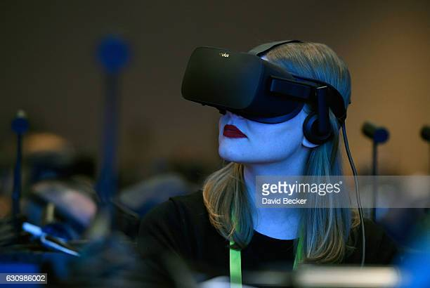 Meghan Purh of California participates in a virtual reality presentation during an Intel press event for CES 2017 at the Mandalay Bay Convention...
