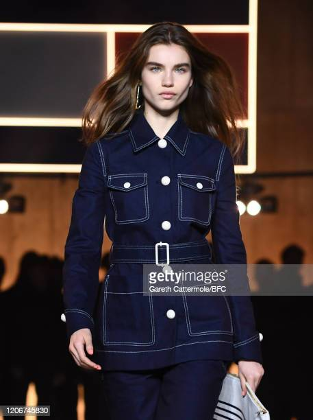 Meghan Roche walks the runway at the TommyNow show during London Fashion Week February 2020 at the Tate Modern on February 16 2020 in London England