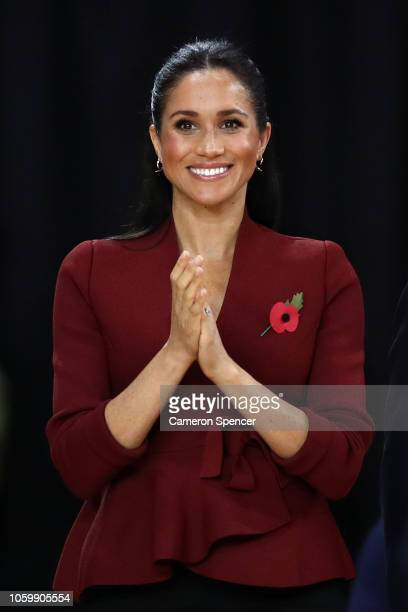 Meghan the Duchess of Sussex applauds during the medal ceremony following the gold medal match of the Wheelchair Basketball between the Netherlands...