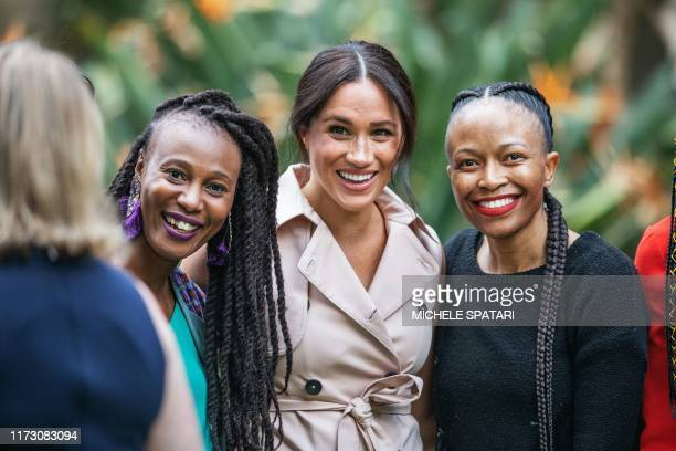 Meghan the Duchess of Sussex arrives at the British High Commissioner residency in Johannesburg where they will meet with Graca Machel widow of...