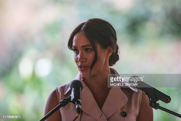 Meghan the Duchess of Sussex delivers a speech at the British High Commissioner residency where she will meet with Graca Machel widow of former South...