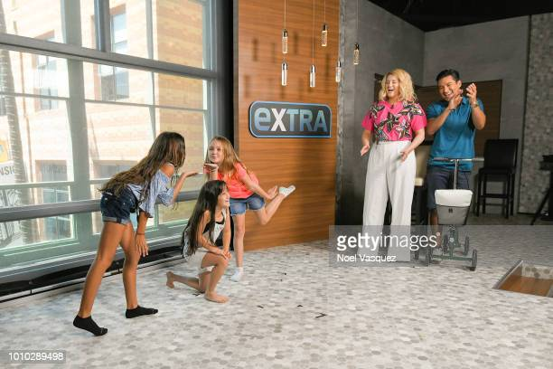 "Meghan Trainor and Mario Lopez watch Gia Francesca Lopez and her friends perform ""Extra"" at Universal Studios Hollywood on July 27, 2018 in Universal..."