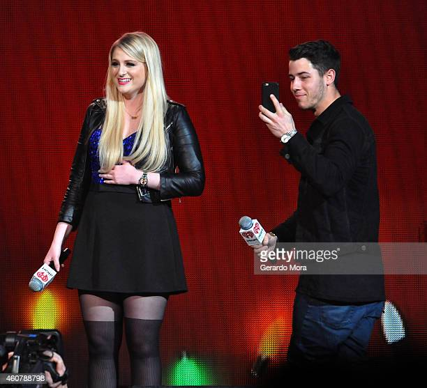 Meghan Trainor celebrates her 21st birthday onstage with Nick Jonas at 93.3 FLZ's Jingle Ball 2014 at Amalie Arena on December 22, 2014 in Tampa,...